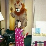"Barbara Haskew as ""Sam"" with our granddaughter Sarah McMullen (age 5) brushing Sam's tail before the concert on Nov 9, 2001 at the Hyatt Hotel in Knoxville, TN"