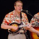 "Tom playing his Gibson ""Sam Bush"" model mandolin"